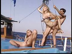Hot threesome on a boat with facial tubes