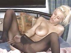 She masturbates while in black pantyhose tubes