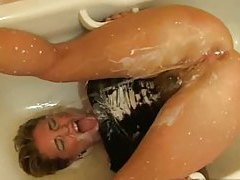 Creamy enema makes a mess on busty girl tubes