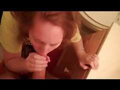 Redhead GF sucks dick in bathroom tubes