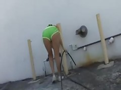 Hottie washes his car in bikini tubes