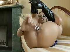 Slut in boots aggressively toy fucks her holes tubes