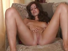 Teen in a skirt strips and masturbates tubes