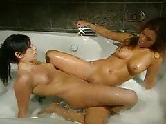 Girls get soapy and sexy in the hot tub tubes
