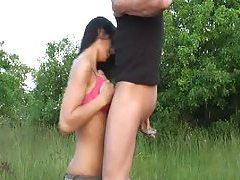 Teen in a field gives a titjob tubes
