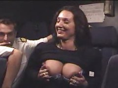 Flight attendant shows tits and ass tubes