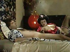 Geisha girl in satin sucks a cock tubes