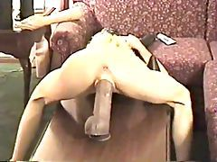 She stretches cunt with a huge toy tubes