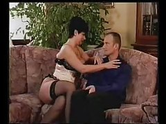 Gal in corset feeds him her tits tubes