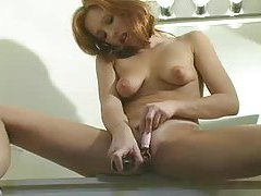 Fun redhead and her toy time tubes