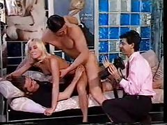 Two guys take her on and ensure her pleasure tubes