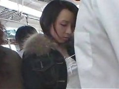Japanese girl giving HJ on crowded train tubes