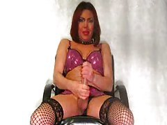 Shemale in fishnets jerking her long cock tubes