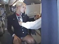 Sexy stew sucking and stroking dick on plane tubes