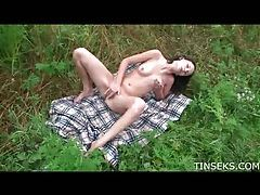 Teen on a blanket in a field masturbating tubes