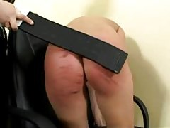 Her ass gets caned and it looks painful tubes