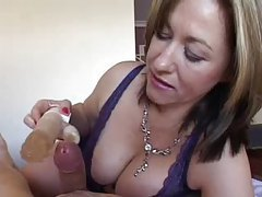 Milf rubs a dildo over his cock tubes