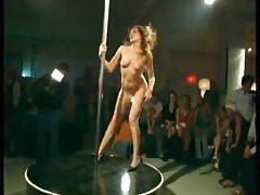 Girl dancing on the pole strips naked tubes