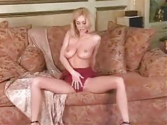 Slim blonde in red lace lingerie uses a blue toy tubes