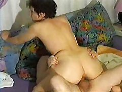 The wife sits on his cock and rides tubes