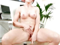 Perky boobs milf redhead sits on a big toy tubes