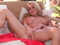 Busty blonde outdoors fingers her pussy tubes