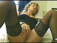 Milf wears arousing lingreie and rubs her clit tubes