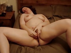 Fat girl toys her fat pussy in homemade movie tubes