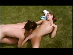 Chicks in the grass finger and eat wet pussy tubes