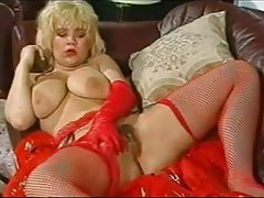 Gloved gal in fishnets gropes tits and cunt tubes