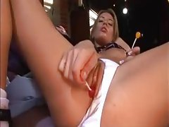 Schoolgirl gets sloppy with two lollipops tubes