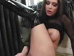 Jessica Jaymes in boots and lingerie teases and toys tubes