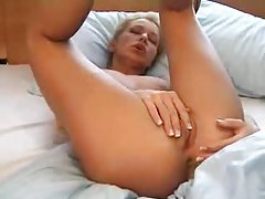 See her use a red dildo in her box tubes