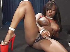 Black girl rams a toy into her cunt tubes