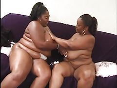 Two fat black girls rub titties tubes
