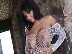 Big tits chick in a fishnet top sucks on cock tubes