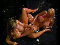 Huge boobs oiled up girls share a big dildo tubes
