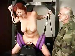 Busty redhead in bondage vibrated tubes