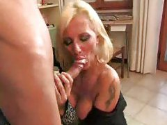 Milf on her knees to suck young cock tubes