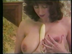 Retro busty girl plays with her dildo tubes