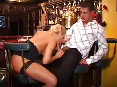 Chick in a gorgeous cocktail dress sucks cock in bar tubes