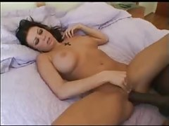 Large black cock cums on her chest tubes