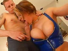 Skintight blue latex top on big tits babe tubes