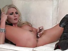 Alicia Secrets in black leather boots masturbates tubes