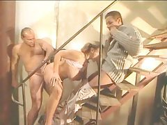 Young curvy girl fucked by two guys on the stairs tubes