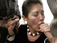 Mature in her work clothes strokes two dicks tubes