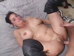 Nice big ass on mature slut in leather boots tubes