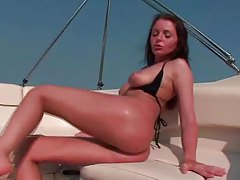 Sexy girl on a boat fingers solo tubes