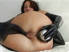Girl in gloves puts beer can in her anal hole tubes