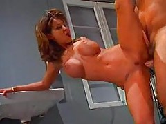 Redhead Audrey Hollander does incredible double fisting tubes
